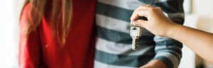 giving keys to new homeowners