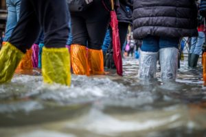 people in flooded waters