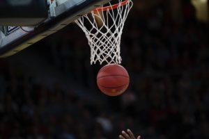 basketball going through basket