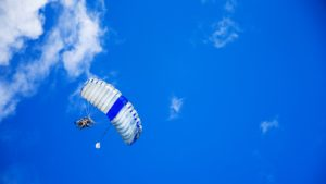 man sailing in the sky with a parachute