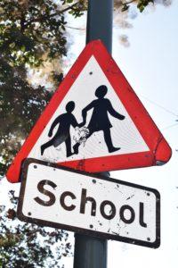 children crossing sign near school