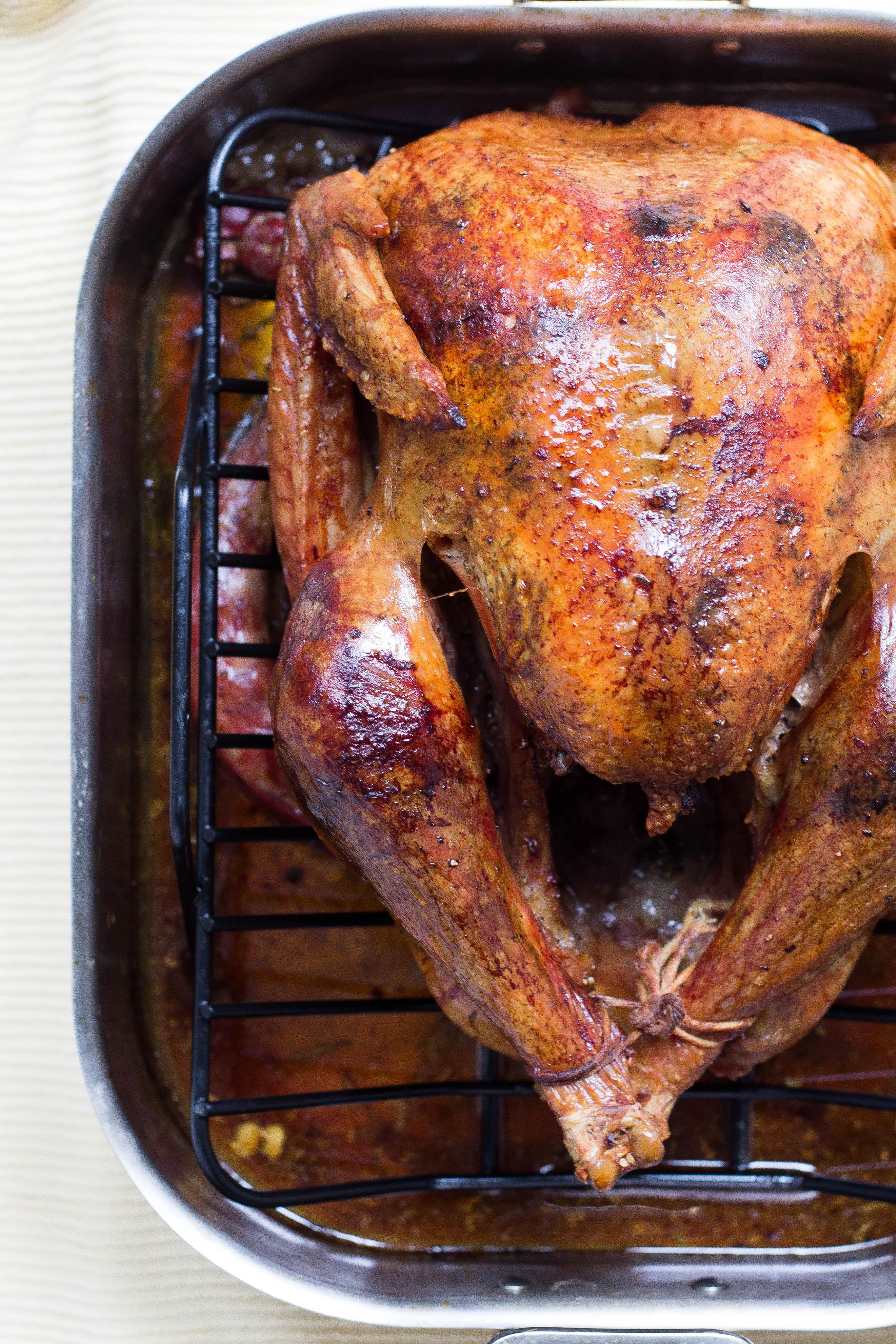 roasted turkey sitting in pan