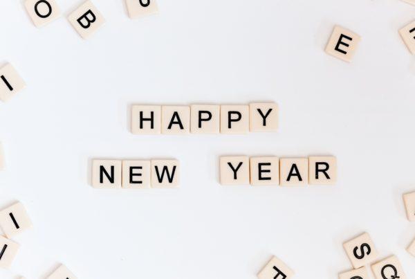 scrabble like blocks spelling out happy new year