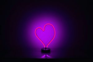 neon pink stand light shaped as a heart