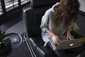 girl working alone on her laptop