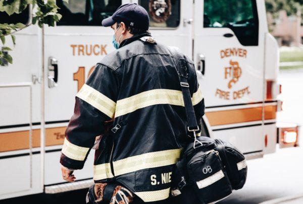 firefighter walking to fire truck